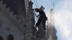 Man cleaning ornate stonework with a water jet, Budapest, Hungary. Stock Footage