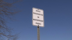 No dogs allowed in park sign Stock Footage
