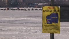 Thin ice warning sign at frozen lake Stock Footage