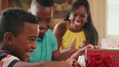Hispanic Boy Opening Gift Box Happy Black Child Celebrating Birthday Stock Footage
