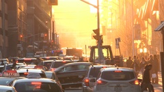 Blinding Orange explosion of sunset in city streets with traffic gridlock Stock Footage