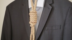 Businessman adjusting a noose rope like tie, going on not your favorite job, Stock Footage