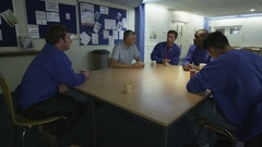 4K Blue collar workers taking a break in the company canteen Stock Footage