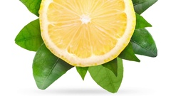 Lemon with green leaves isolated on white background Stock Footage