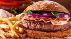Burger and french fries with meat and vegetables Stock Footage