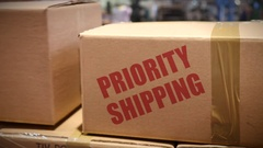 Priority Shipping cartons at logistics center Stock Footage