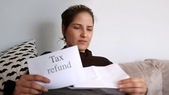 Woman receives tax refund Stock Footage