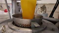 Extrusion of yellow plastic in a factory Stock Footage