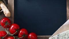 Italian food on vintage wood background with chalkboard Stock Footage