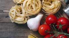 Ingredients for an Italian pasta recipe on rustic wood Stock Footage