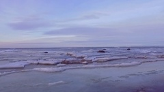 Cracks in baltic sea ice floating and shifting. Coastline. Stock Footage