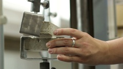 Specialist Conducts Test on Cement Strength Stock Footage
