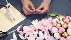 Close-up of corrugated paper hack bright pink in female hands. Female decorator Stock Footage