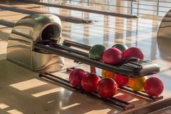 Bowling balls on the ball return device in bowling alley Stock Photos