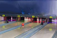 Lanes and bowling pins in a modern pin bowling alley Stock Photos