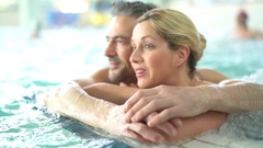 Couple relaxing in thalassotherapy thermal water Stock Footage