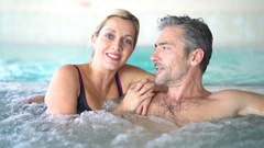 Couple relaxing in thalassotherapy hot tub Stock Footage