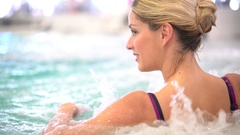 Middle-aged woman enjoying thermal bath in thalassotherapy center Stock Footage