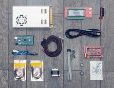 Flat lay of electronic and mechanical parts and components of DIY device Stock Photos
