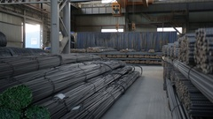 Warehouse full of tied reinforcing steel bars m/s left to right Stock Footage