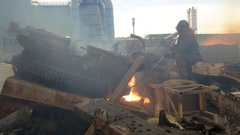 Workman cutting scrap metal with open fire Stock Footage