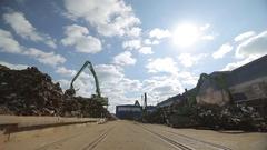 Crane unloads scrap metal Stock Footage