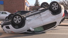 SUV car accident and crash with rollover in city intersection Stock Footage