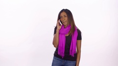 A women gets upsetting news on a phone call. Wide shot on white background. Stock Footage