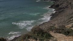 4k Beautiful rough coastline cliffs and ocean beach zoom out at Sagres Portugal Stock Footage