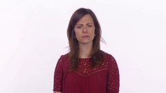 A woman sees and reacts to something really disturbing. Medium shot on white Stock Footage