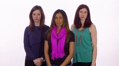 Three women show their disappointment and cross their arms. Medium shot on Stock Footage