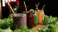 Various freshly blended smoothies on wooden tray Stock Footage