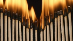 SLOW MOTION: Row of burning matchsticks Stock Footage