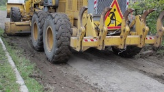 Grader leveled soil on the road Stock Footage