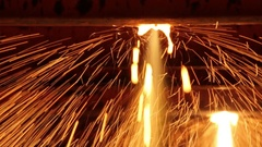 Red-hot iron balk move in the discharge line in the steel shop Stock Footage