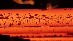 Finished iron beams emerge from the steel foundry Stock Footage