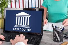 Law courts concept on a laptop Stock Photos
