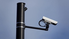 Whip pan to a surveillance camera Stock Footage