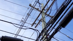 Close up view of a power pole covered in utility cable Stock Footage
