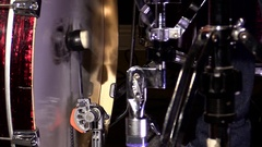 Close up shot of a drum pedal hitting the bass drum in slow motion Stock Footage