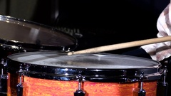 Slow motion close up shot of drums sticks hitting a snare drum with a tom drum Stock Footage