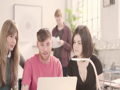 Young adults talking in busy startup office - track left past glass wall. Stock Footage