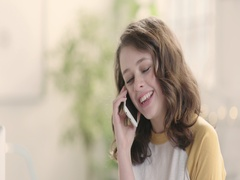 Portrait of happy girl in bright startup office using mobile phone track left Stock Footage